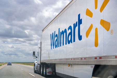 May 25, 2018 Bakersfield / CA / USA - Walmart truck driving on the interstate on a cloudy day Editorial