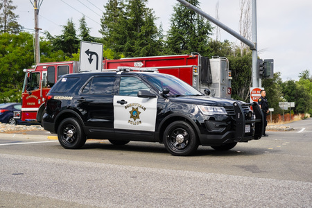 July 13, 2018 Sunnyvale  CA  USA - Police car and Fire Truck stopped at the scene of an accident in south San Francisco bay area