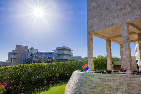 June 8, 2018 Los Angeles  CA  USA - Landscape at modern Getty Center; medieval looking colonnade and walls covered in travertine in the foreground; designed by Richard Meier;