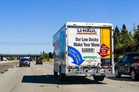 June 23, 2018 Sacramento / CA / USA - U-Haul van travelling on the interstate; U-Haul is an American company offering DIY moving solutions