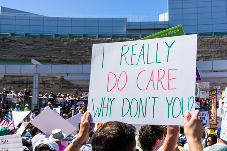 June 30, 2018 San Jose  CA  USA - I really do care Why dont you sign raised at the Families belong together rally held in front of the City Hall in San Jose, Silicon Valley