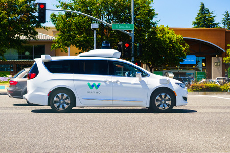 July 10, 2018 Mountain View / CA / USA - Waymo self driving car cruising on a street in south San Francisco bay area, Silicon Valley Editorial