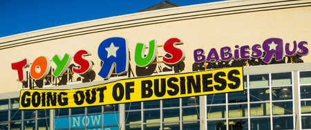 April 20, 2018 San Mateo  CA  USA - Toys R Us , Babies R Us logos and Going out of business announcement above the entrance to one of the stores in San Francisco bay area Editorial