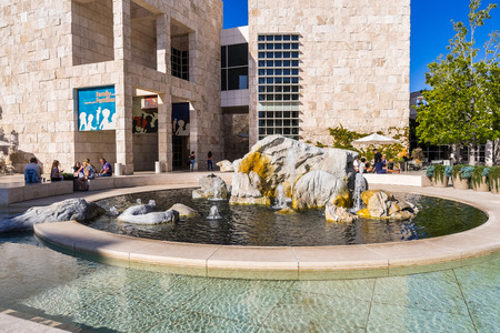 June 8, 2018 Los Angeles / CA / USA - Visitors resting around the water fountain in the museum courtyard of the Getty Center Editorial