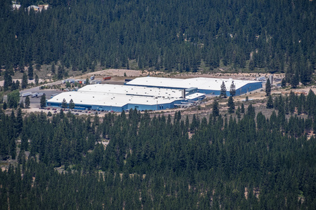 June 25, 2018 Weed  CA  USA - Aerial view of Crystal Geyser Alpine Spring Water by CG Roxane facility, surrounded by forests, located at the foot of Mount Shasta; Northern California