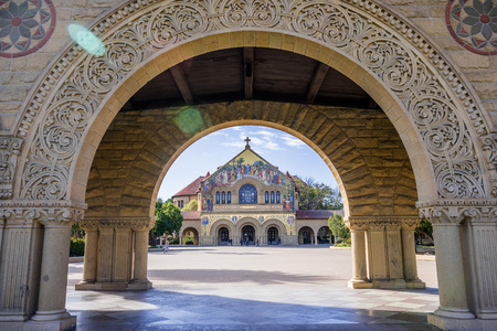 February 20, 2018 Palo Alto / CA / USA - Memorial Church at Stanford seen through an arch in the colonnade surrounding the main quad; San Francisco bay area