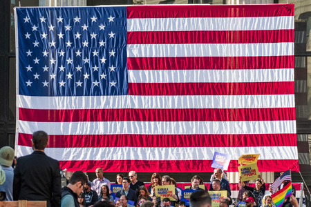 January 27, 2019 Oakland  CA  USA - Large American flag at the Kamala Harris for President Campaign Launch Rally held in Frank H Ogawa Plaza in downtown Oakland