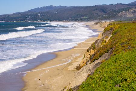 The coastal cliffs and beach of Half Moon Bay, California