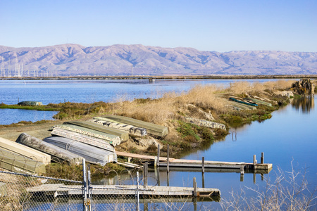 Boats on a levee, Moffett trail, south San Francisco bay, California Archivio Fotografico