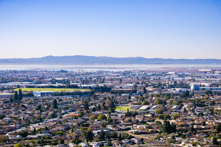 View towards the towns of east bay; San Mateo bridge on the background, San Francisco bay area, Hayward, California
