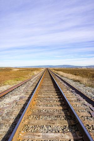 Railroad tracks across marshland, Alviso, California Stock Photo