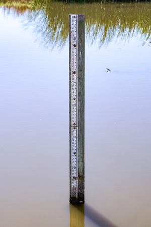 Flood level depth marker post, California 版權商用圖片