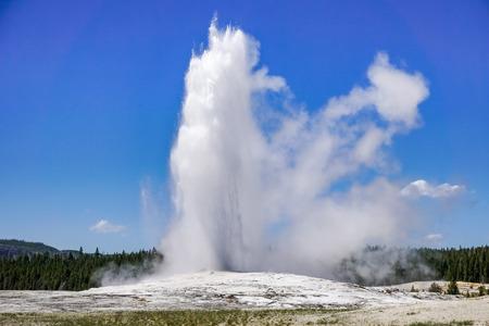 The Old Faithful geyser erupting, Yellowstone National Park Stock Photo
