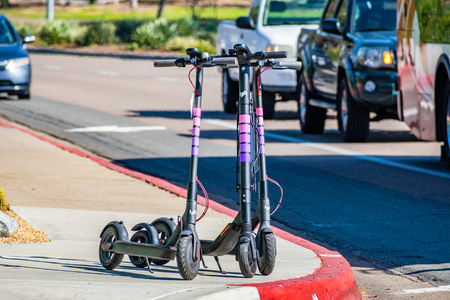 March 19, 2019 San Diego  CA  USA - Lyft electric scooters parked on a sidewalk Editorial