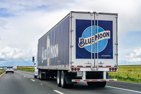March 20, 2019 Los Angeles  CA  USA - Blue Moon branded truck driving on the interstate