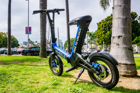 March 19, 2019 San Diego  CA  USA - Wheels custom designed mini bike parked in Balboa Park; Wheels is a new dockless e-vehicle start-up launched at the beginning on 2019
