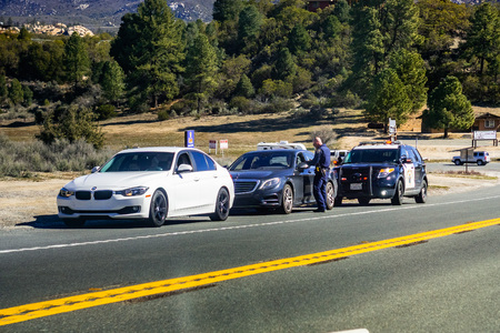 March 17, 2019 Idyllwild / CA / USA - Cars stopped on the right side of the road by the Highway Patrol