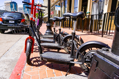 March 19, 2019 San Diego  CA  USA - Razor Share and Lyft Escooters parked side by side on the sidewalk in downtown San Diego