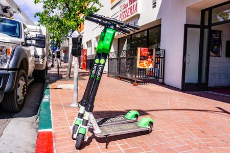 March 19, 2019 San Diego  CA  USA - Lime Scooters parked on the sidewalk in downtown San Diego