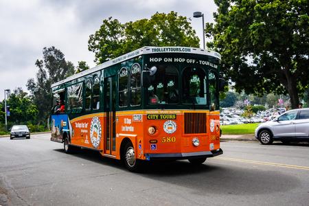 March 19, 2019 San Diego / CA / USA - Hop on / Hop Off trolleybus taking people on a city tour of San Diego Redakční