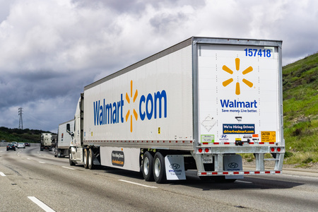March 20, 2019 Los Angeles  CA  USA - Walmart truck driving on the interstate among hills on a cloudy day