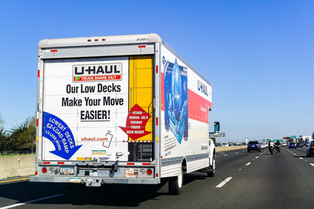 March 31, 2019 Oakland / CA / USA - U-Haul van travelling on the freeway in San Francisco bay area; U-Haul is an American company offering DIY moving solutions Editorial