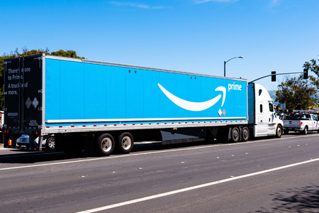 April 12, 2019 Newark  CA  USA - Amazon truck driving on a street in East San Francisco bay area; the large Prime logo printed on the side Redakční