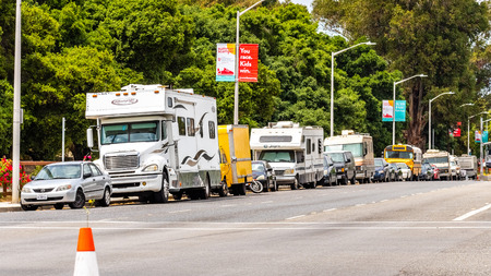 May 9, 2019 Palo Alto  CA  USA - Campers and RVs parked on the side of El Camino Real, close to Stanford in San Francisco bay area, Silicon Valley; symbol of housing crisis