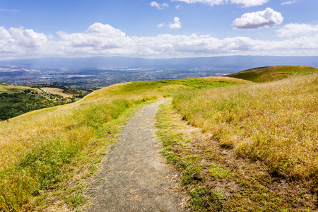 Hiking trail through the hills of south San Francisco bay area, San Jose visible in the background, California Zdjęcie Seryjne
