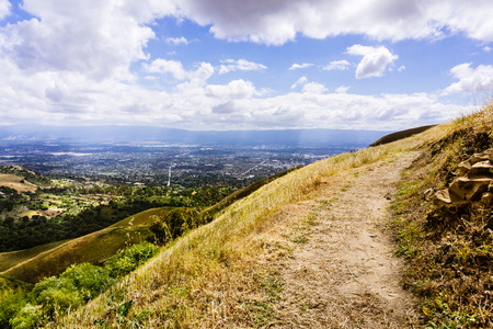 Hiking trail through the hills of south San Francisco bay area, San Jose visible in the background, California Stock Photo