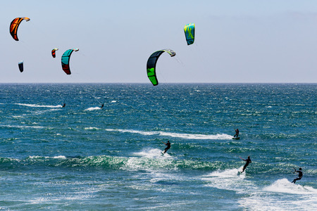June 6, 2019 Davenport  CA  USA - People kite surfing in the Pacific Ocean, near Santa Cruz, on a sunny and warm day