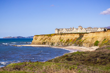 January 5, 2017 Half Moon Bay  CA  USA - The Ritz Carlton Hotel on the Pacific Ocean Coastline on top of eroded cliffs