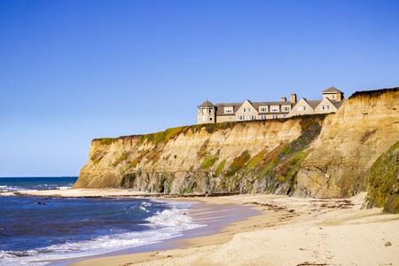 January 5, 2017 Half Moon Bay  CA  USA - Sandy beach and the Ritz Carlton Hotel on the Pacific Ocean Coastline