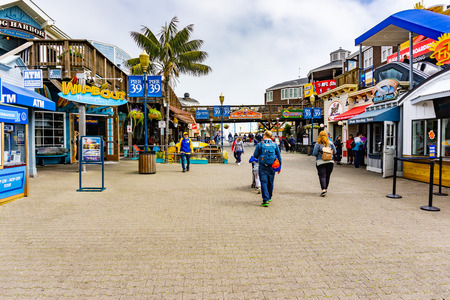 June 3, 2019 San Francisco  CA  USA -  Visitors walk on Pier 39, a shopping center and popular tourist attraction built on a pier in Fishermans Wharf neighborhood