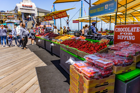 June 3, 2019 San Francisco  CA  USA -  Fruit stand on Pier 39, a shopping center and popular tourist attraction built on a pier in Fishermans Wharf neighborhood