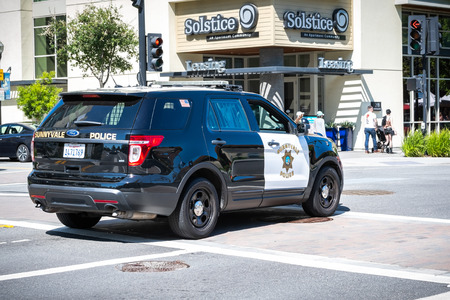 June 2, 2019 Sunnyvale / CA / USA - Police car driving on the street in downtown Sunnyvale, South San Francisco bay area