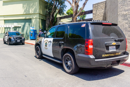 May 24, 2019 Sunnyvale  CA  USA - Two police cars stopped in front of a store in downtown Sunnyvale, South San Francisco bay area Redakční