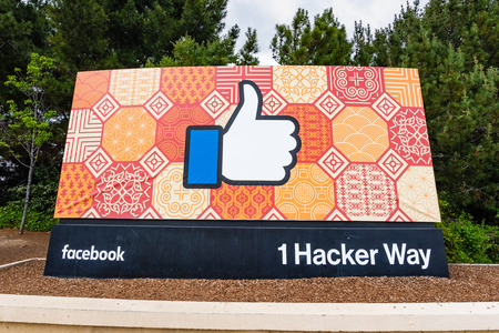 May 26, 2019 Menlo Park  CA  USA  - The Facebook Like Button sign located at the entrance to the companys main headquarters located in Silicon Valley; customized, colorful background