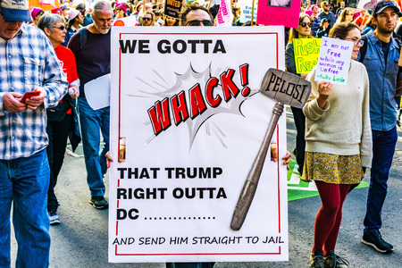 January 19, 2019 San Francisco  CA  USA - Participant to the Womens March event holds We Gotta Whack that Trump right Outta DC sign while marching on Market street in downtown San Francisco Editorial