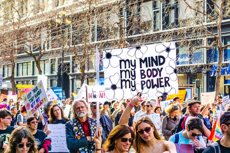 January 19, 2019 San Francisco  CA  USA - Participant to the Womens March event holds My body, my choice, my power sign while marching on Market street in downtown San Francisco Redakční