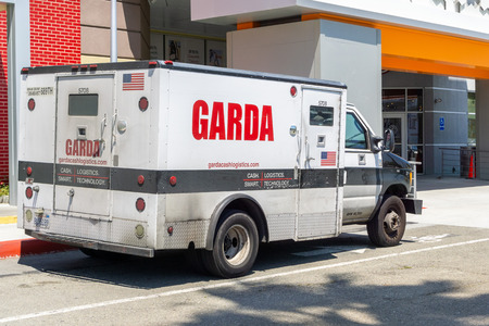May 30, 2019 Milpitas  CA  USA - Garda armored truck safely transporting cash; Garda Cash Logistics , Inc. operates as a subsidiary of Garda World, a Canadian private security firm Redakční