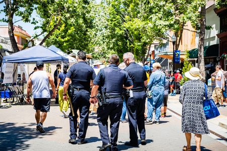June 2, 2019 Sunnyvale  CA  USA - Police patrolling the streets of downtown Sunnyvale during the Art, Wine & Music Festival in downtown Sunnyvale, South San Francisco bay area