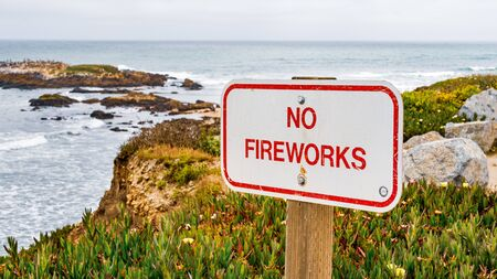 No Fireworks sign posted on the Pacific Ocean coastline, California