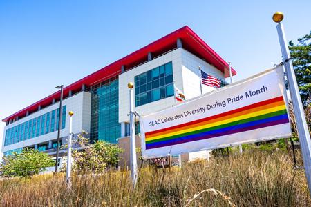 June 21, 2019 Menlo Park / CA / USA - Pride Flag displayed near the entrance to SLAC National Accelerator Laboratory (originally named Stanford Linear Accelerator Center)