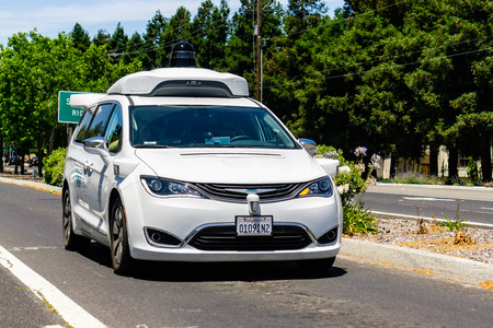 July 1, 2019 Mountain View / CA / USA - Waymo self driving car performing tests on a street near Google's headquarters, Silicon Valley; Waymo, a subsidiary of Alphabet, is developing an autonomous car