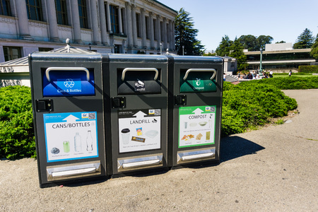 July 13, 2019 Berkeley / CA / USA - Recycling (cans and bottles), Landfill (garbage and some types of plastics) and Compost (food and other compostable items) garbage bins on UC Berkeley campus;