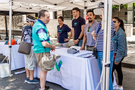 July 16, 2019 Mountain View / CA / USA - Representatives from Waymo talk to visitors at Technology Showcase event in Silicon Valley