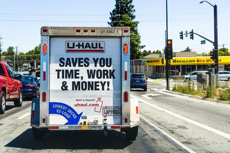 July 10,  2019 Redwood City / CA / USA - U-Haul van travelling through a city in San Francisco bay area; U-Haul is an American company offering DIY moving solutions Redakční