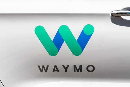 July 16, 2019 Mountain View / CA / USA - Close up of Waymo logo on the side of one of their self driving cars, in testing at this moment on the streets of Silicon Valley Redakční