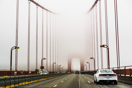 July 4, 2019 San Francisco / CA / USA - Driving on the Golden Gate Bridge on a foggy day; it is a suspension bridge spanning the Golden Gate, the one-mile-wide strait connecting SF bay to the Ocean Sajtókép